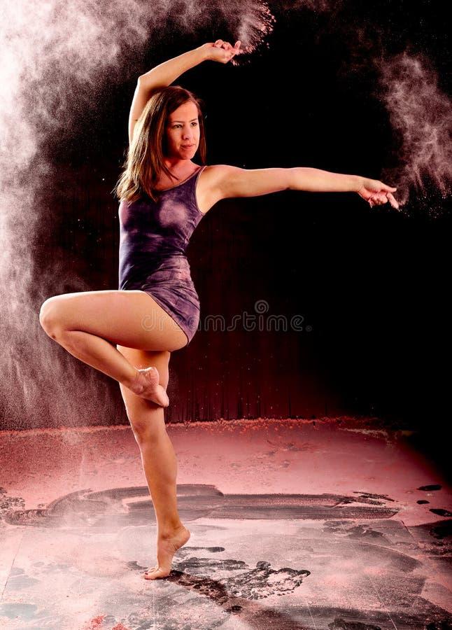 Pink powder dance pose stock photography