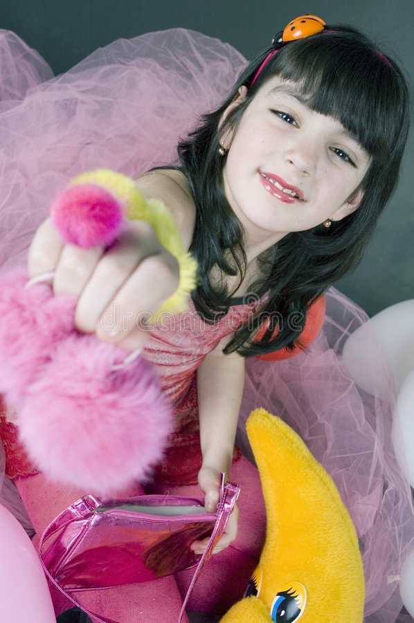 Pink princess. Little girl showing her pink garments stock photography