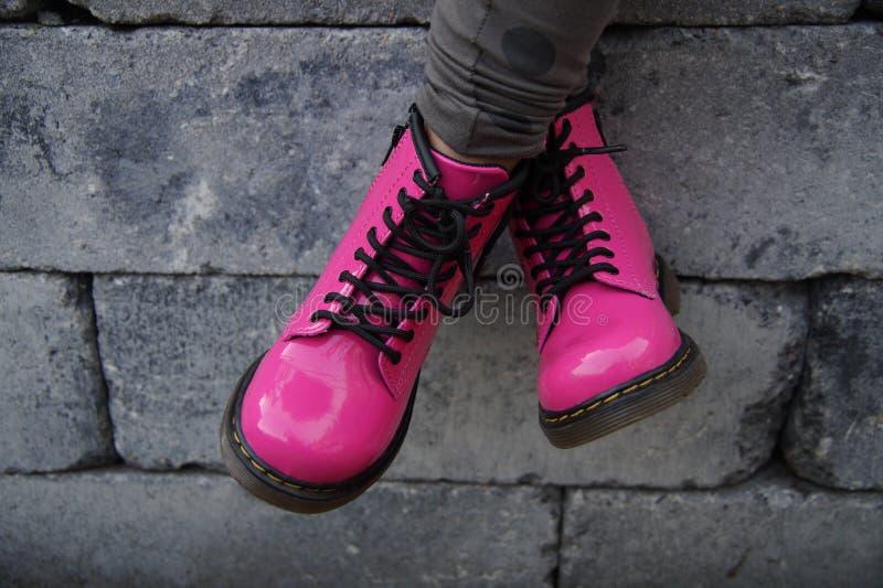 Pink punk alternative girl or woman shoes - cross legged stock image
