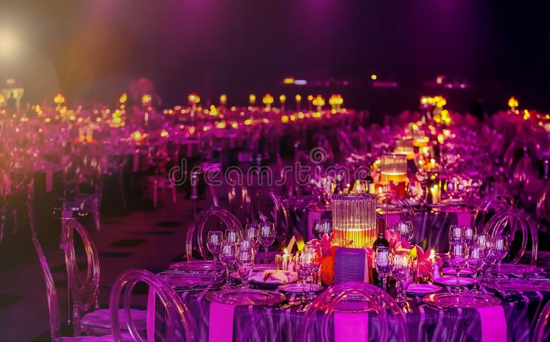 Pink and Purple Christmas Decor with candles and lamps for a large party or Gala Dinner royalty free stock images