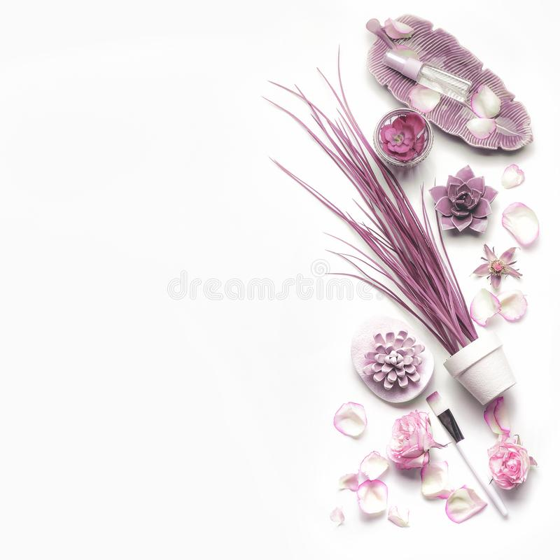 Pink purple cosmetic set for facial skin care with roses on white background, top view, place for text. Beauty and nature herbal cosmetic concept stock photography