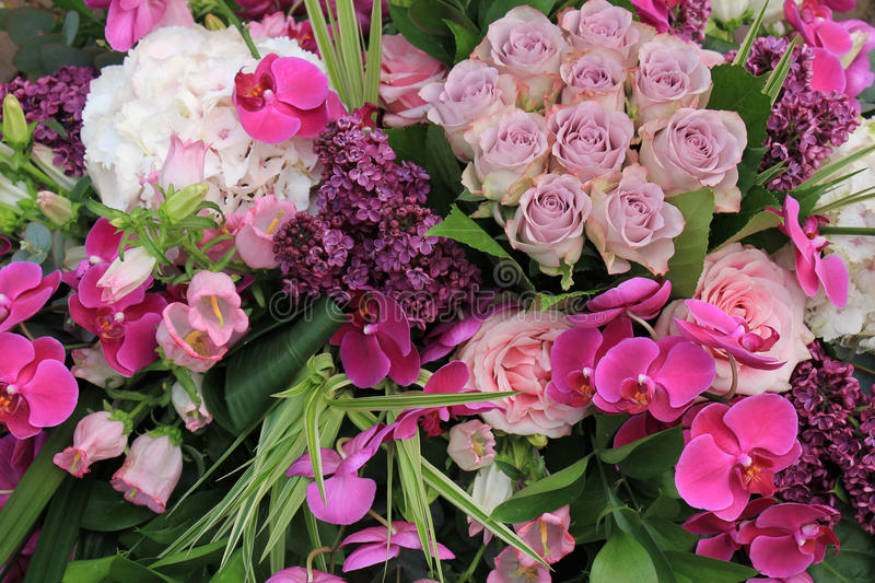 Pink and purple wedding flowers stock photography