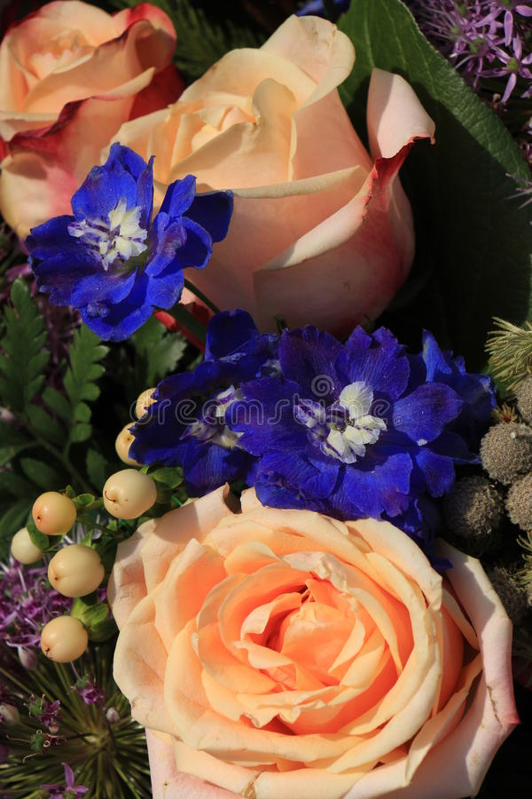 Pink and purple wedding flowers stock image