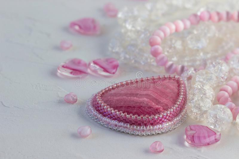 Pink quartz, glass beads for making necklaces. stock image