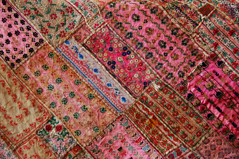 Pink Quilt. Detail of a vintage patchwork crazy quilt using pink fabric pieces stock photos