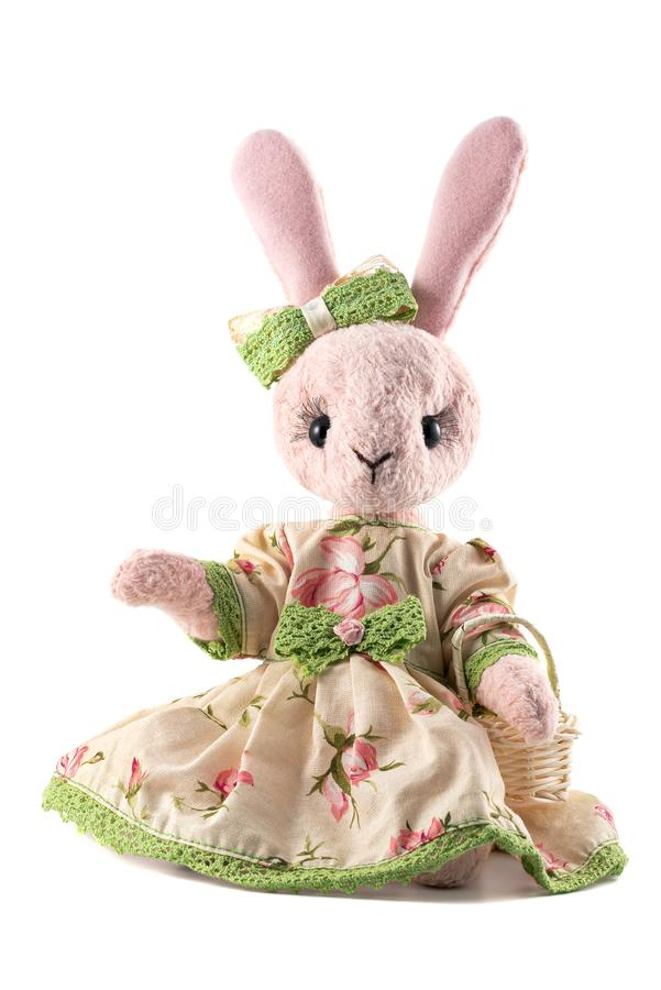 Pink plush toy rabbit in dress isolated on white background stock photo