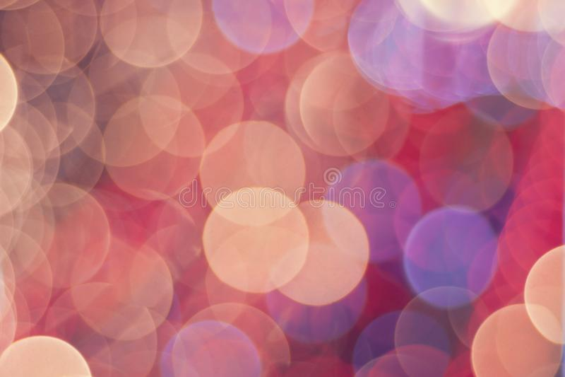 Pink and red background with their repeating bokeh. stock image