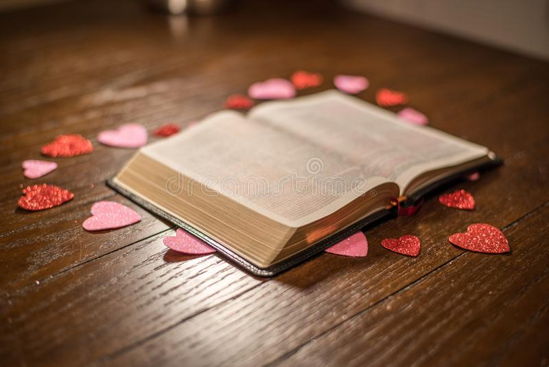 Valentines heart and bible on wooden table stock photo