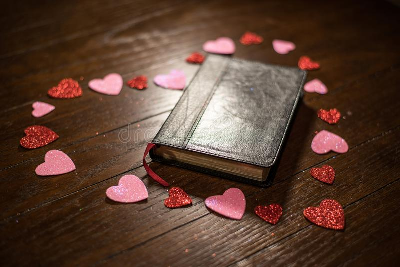 Valentines heart and bible on wooden table royalty free stock image