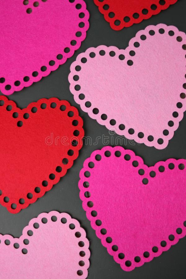 Pink and Red Hearts Over Black Background stock photo