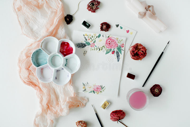 Pink and red roses painted with watercolor, paintbrush and roses on white wooden background stock image