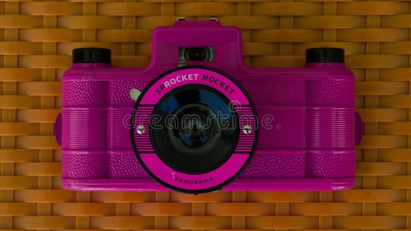 Pink retro camera stock images