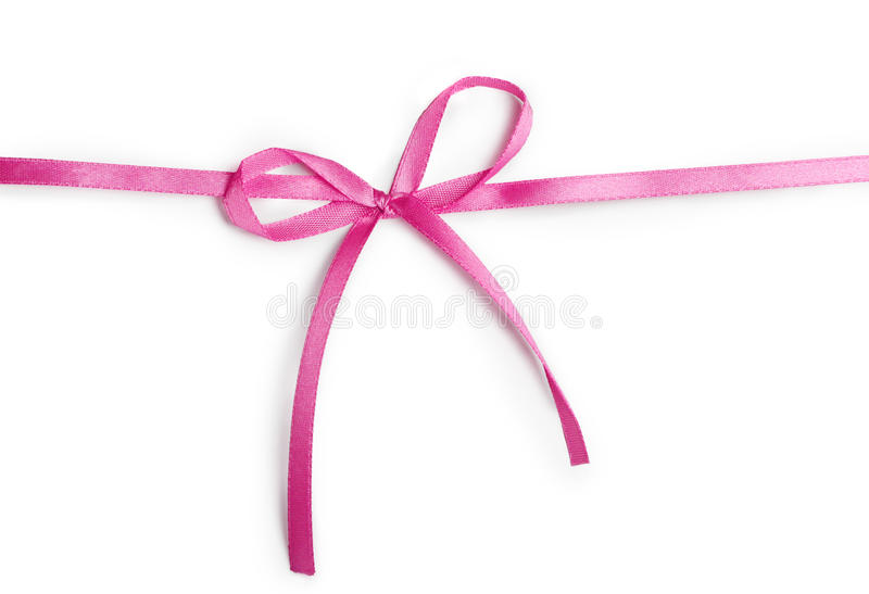 Pink ribbon. With bow isolated on a white background stock images