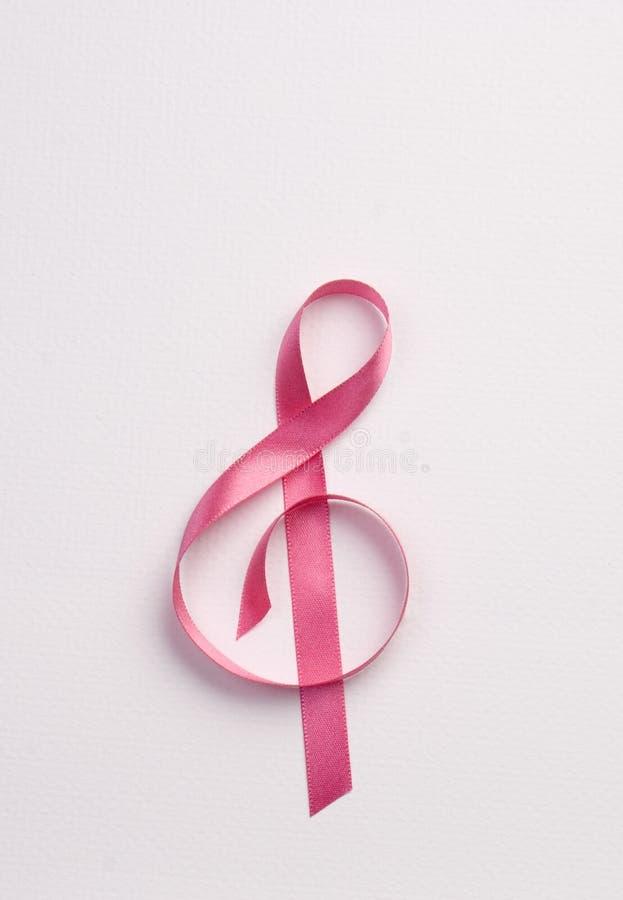 Pink ribbon. A pink ribbon forming a musical note stock photos
