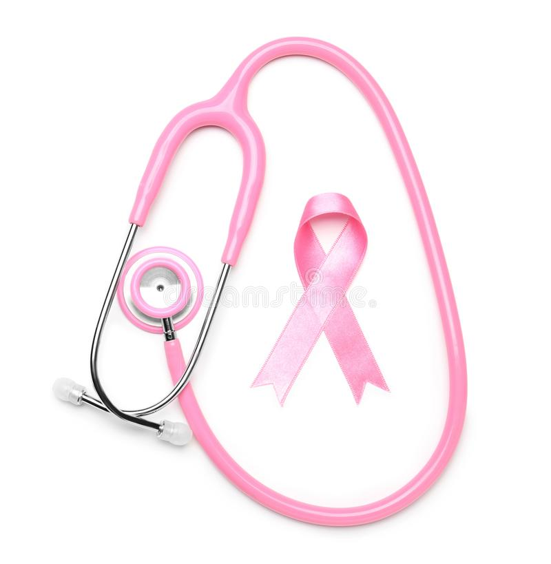 Pink ribbon and stethoscope on white background. Breast cancer awareness concept stock photo