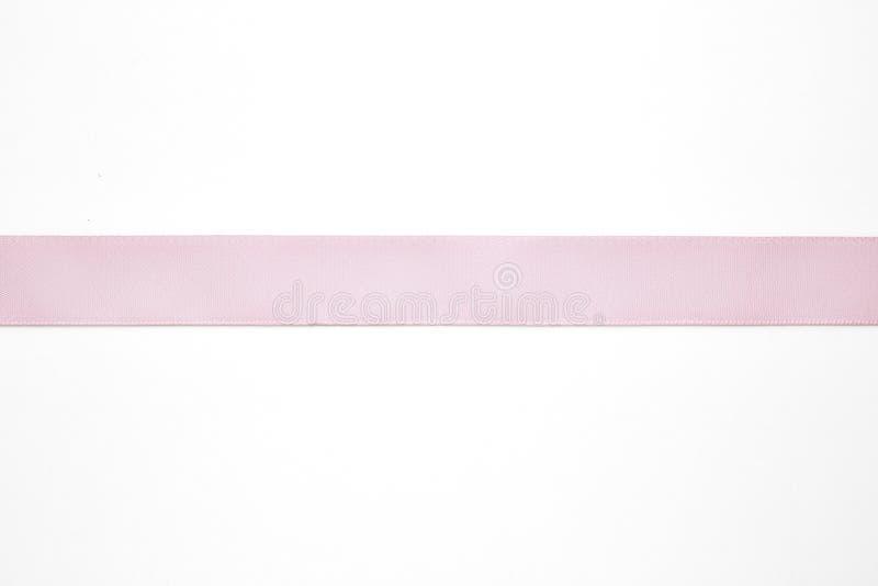 Pink ribbon on white. Background stock photo