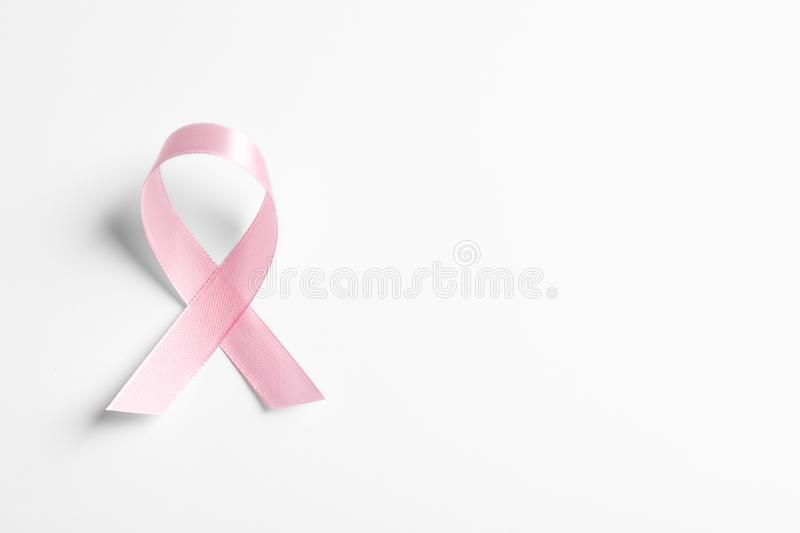 Pink ribbon on white background. Cancer awareness. Pink ribbon on white background, top view. Cancer awareness royalty free stock photography