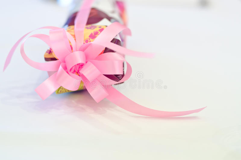 Pink ribbon on white table. Use for gift concept royalty free stock photography