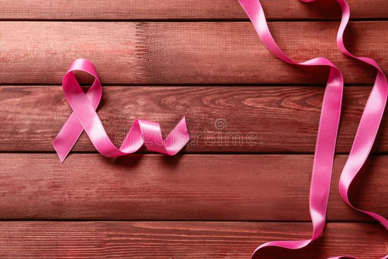 Pink ribbons on wooden background. Breast cancer awareness concept royalty free stock image