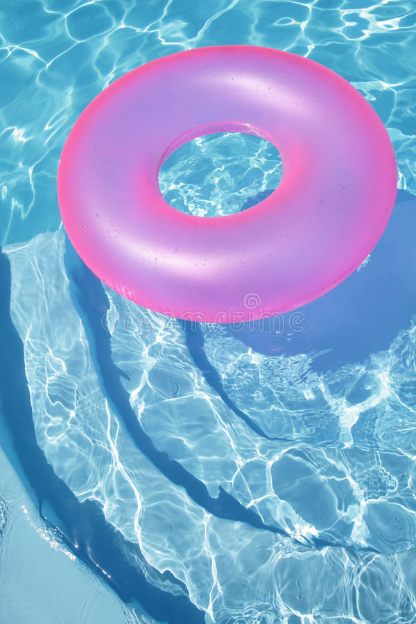 Pink Ring Floating in a Blue Pool royalty free stock photo