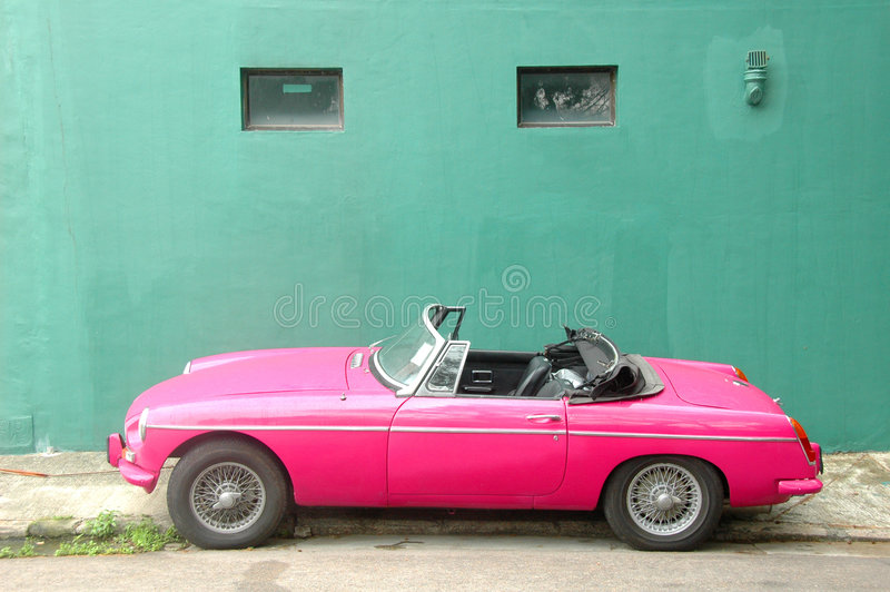 Pink Roadster Car. Old Style Pink Roadster Car royalty free stock photos