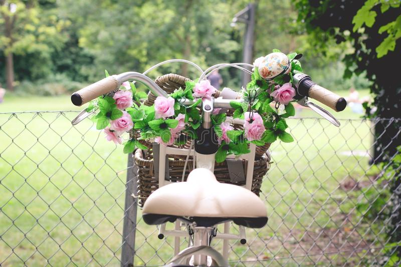Pink Rose Bouquet in Brown Bicycle Basket stock photos