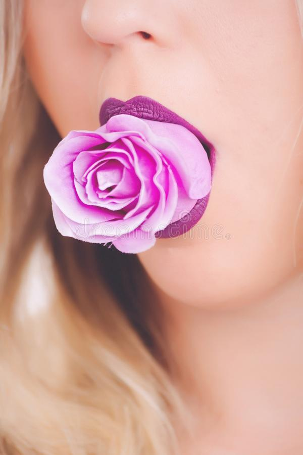 Pink Rose Flower on Woman's Mouth royalty free stock photo