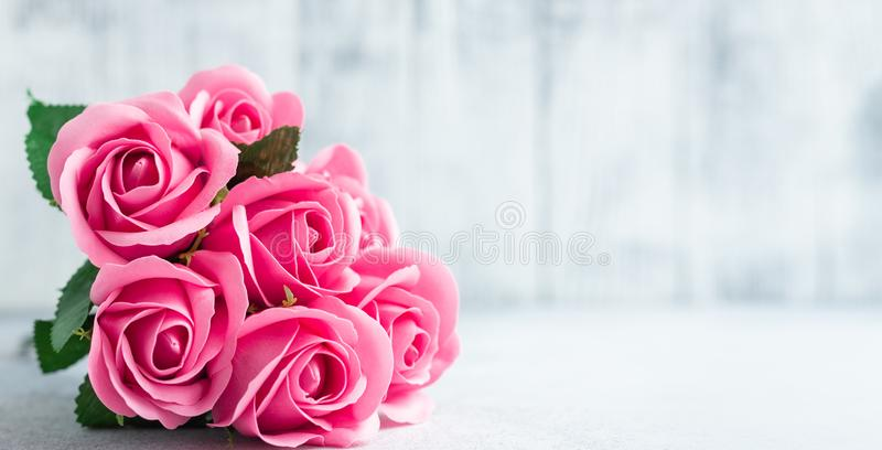Pink rose flowers bouquet on white wooden background Beautiful flowers stock photography