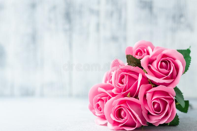 Pink rose flowers bouquet on white wooden background Beautiful flowers royalty free stock photo