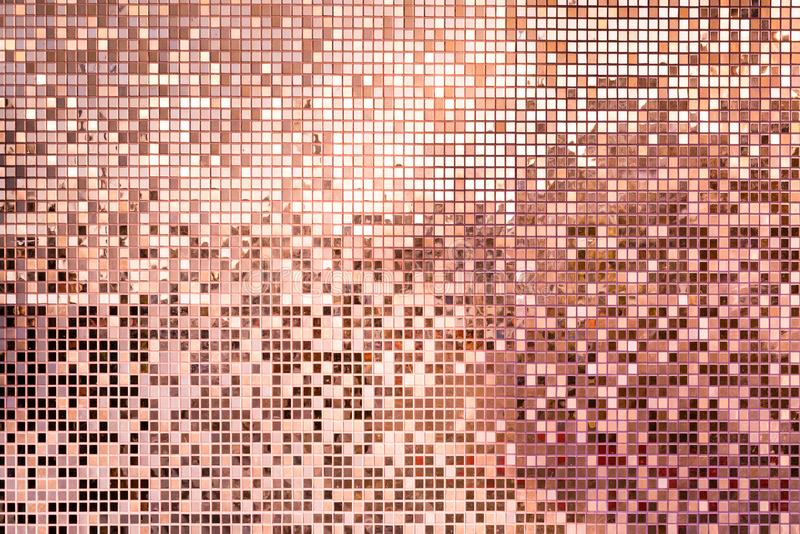 Pink rose gold square mosaic tiles for background. Pink rose gold square mosaic tiles for texture background stock photo