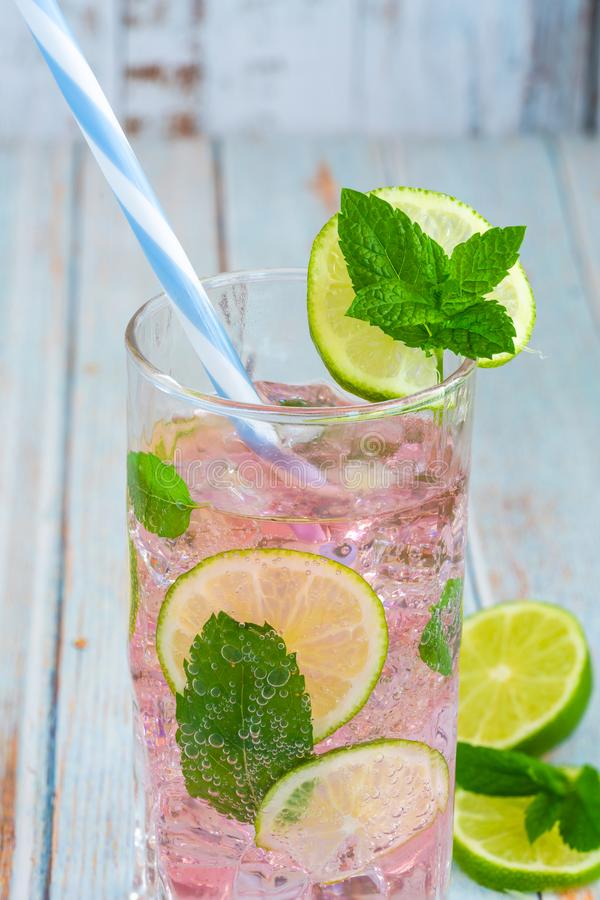 Pink rose lemonade with lime and fresh mint royalty free stock images
