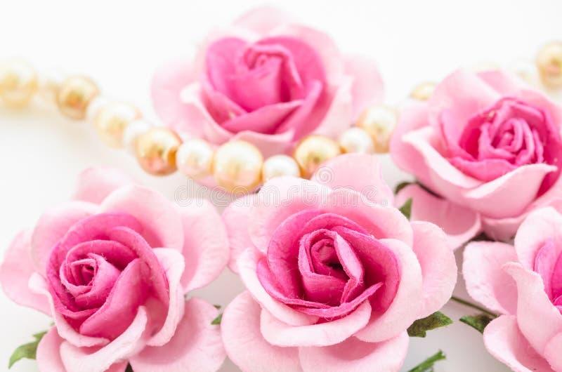 Pink rose with pearls . Pink rose with pearls on white background royalty free stock photos