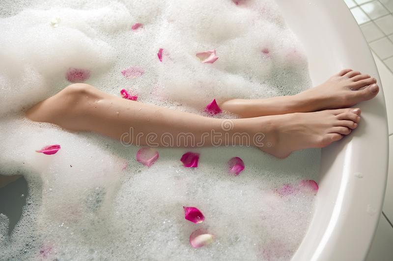 Pink rose petals in a round tub. With legs girls royalty free stock image