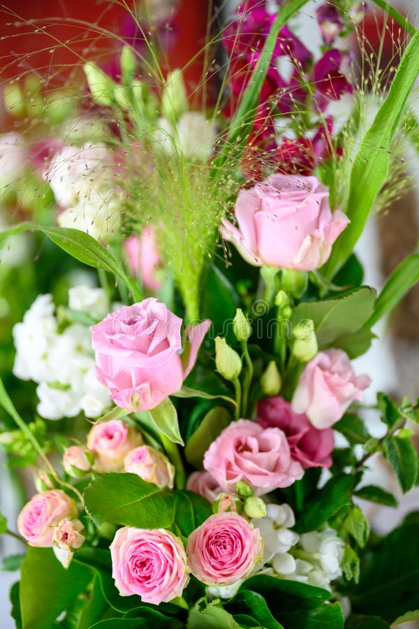 Pink roses in beautiful summer flower arrangement with grasses, white phloxes royalty free stock images