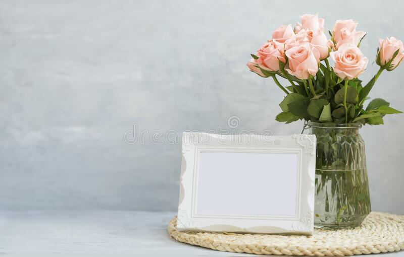 Pink roses bouquet in a vase stock photo