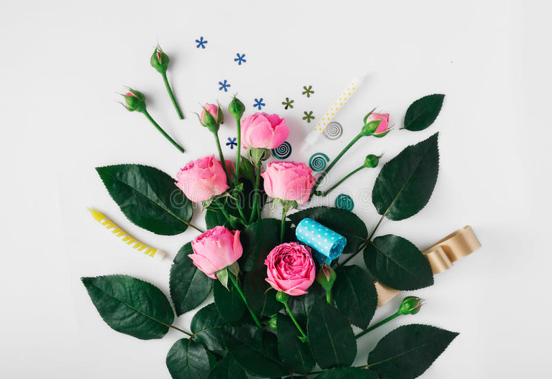 Pink roses with party confetti, noise makers and candles stock photos