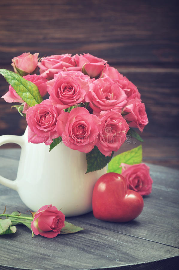 Download Pink Roses With Stone Heart Stock Photo - Image: 39174356