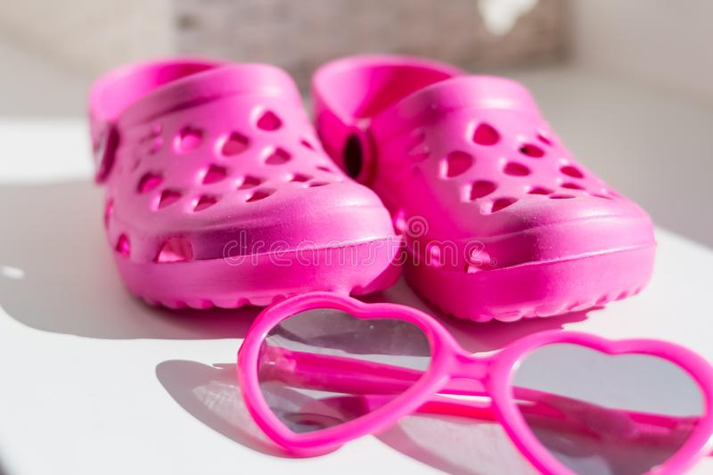 Pink rubber slippers,  on white background. Children`s rubber sandals isolated.Comfortable shoes for beach stock images