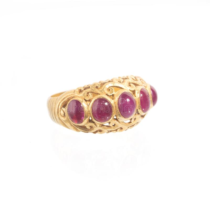Pink ruby on gold ring. Traditional production royalty free stock photo