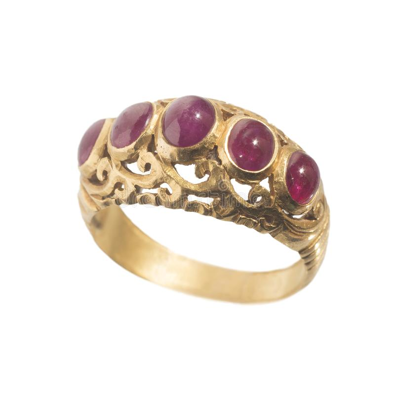 Pink ruby on gold ring. Traditional production stock photography
