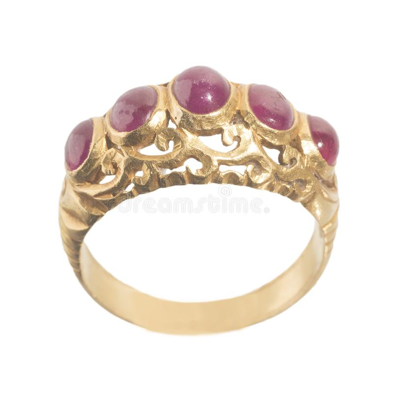 Pink ruby on gold ring. Traditional production royalty free stock image
