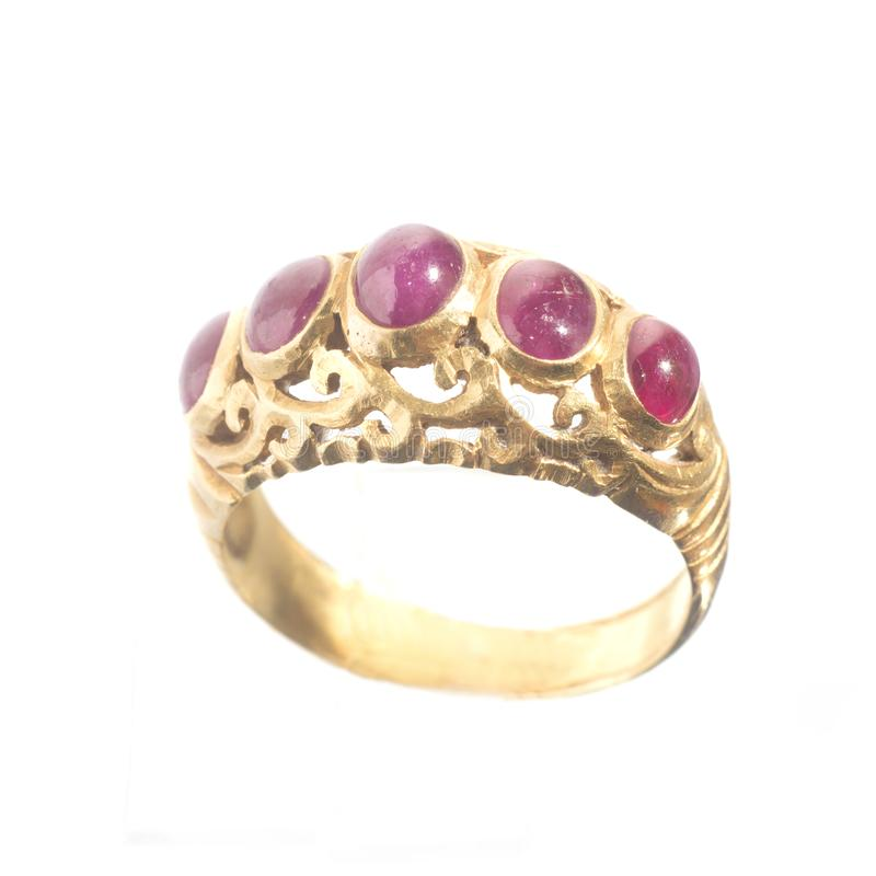 Pink ruby on gold ring stock photos