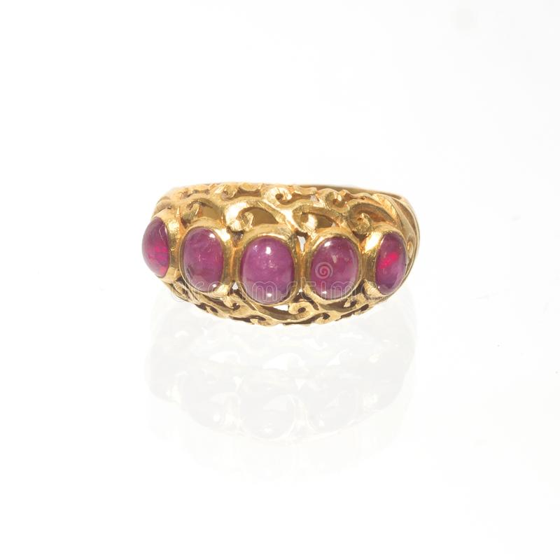 Pink ruby on gold ring , Traditional production. On white royalty free stock photos