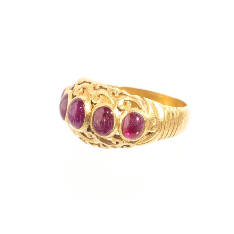 Pink ruby on gold ring , Traditional production. On white royalty free stock image