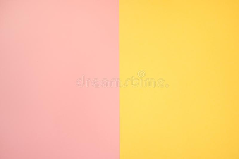 Pink salmon and yellow color paper, abstract background. Pink salmon and yellowcolor paper, abstract background in two colors stock photo