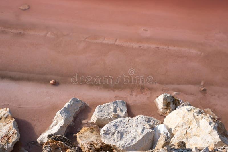 Pink salt pan at Margherita Di Savoia in Puglia, Italy. Water is pink crustaceans that live in it. Pink salt flats at Margherita Di Savoia, north of Bari in stock image