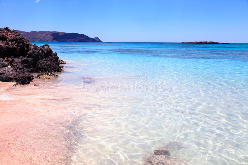 Pink sand beach Elafonisi, Crete island, Greece. Pink sand beach with azure clear water of famous Elafonisi (or Elafonissi), Crete island, Greece stock photos