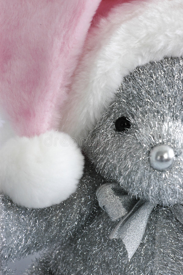 Pink Santa hat on teddy bear royalty free stock photography