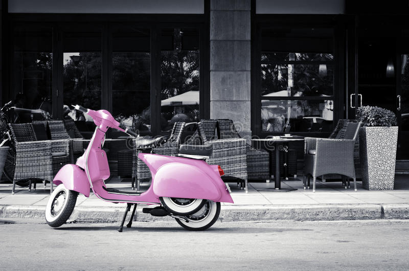 Pink scooter. In front of a coffee house
