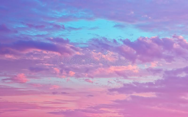 Pink And Serene Fluffy Cumulus Clouds In The Sky stock photography